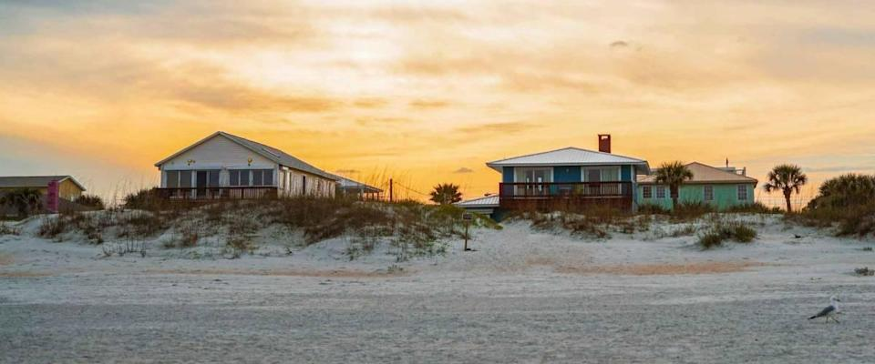 St. Augustine, Florida - March 8, 2019: Beautiful beach houses on St. Augustine Beach in Florida at sunset.