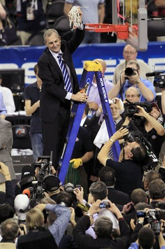 Jim Calhoun holds the net after Connecticut won the NCAA men's title in 2011. (AP)