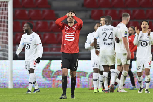 Rennes' Clement Grenier, 2nd left, reacts at the end of a French League One Soccer match between Rennes and Lille at the Roazhon Park stadium in Rennes, France, Sunday Jan. 24, 2021. (AP Photo/David Vincent)