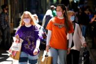 Shoppers walk down a city laneway after coronavirus disease restrictions were eased in Melbourne