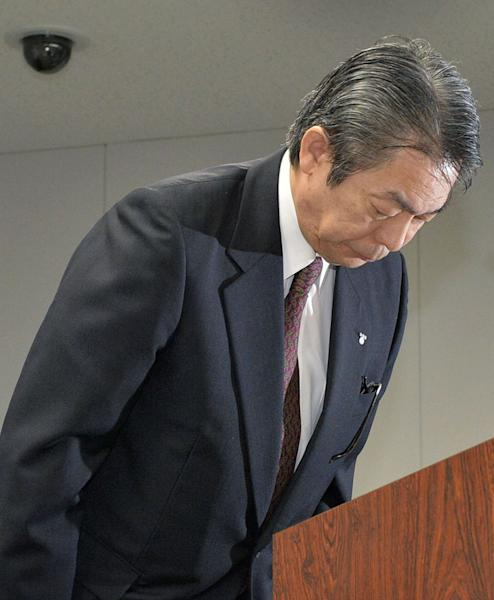 In this Aug. 21, 2013 photo, Tokyo Electric Power Co.'s Executive Vice President Zengo Aizawa bows in apology for a leak of highly radioactive water at the crippled Fukushima nuclear power plant, during a press conference at the company's headquarters in Tokyo. Deep beneath Fukushima's crippled nuclear power station a vast underground reservoir of highly contaminated water that began spilling from the plant's reactors during the 2011 earthquake and tsunami has been creeping slowly toward the sea. (AP Photo/Kyodo News) JAPAN OUT, MANDATORY CREDIT