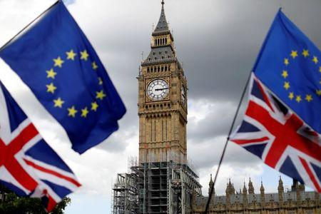 Union Flags and European Union flags fly near the Elizabeth Tower housing the Big Ben bell during the anti Brexit 'People's March for Europe&#39, in Parliament Square in central London