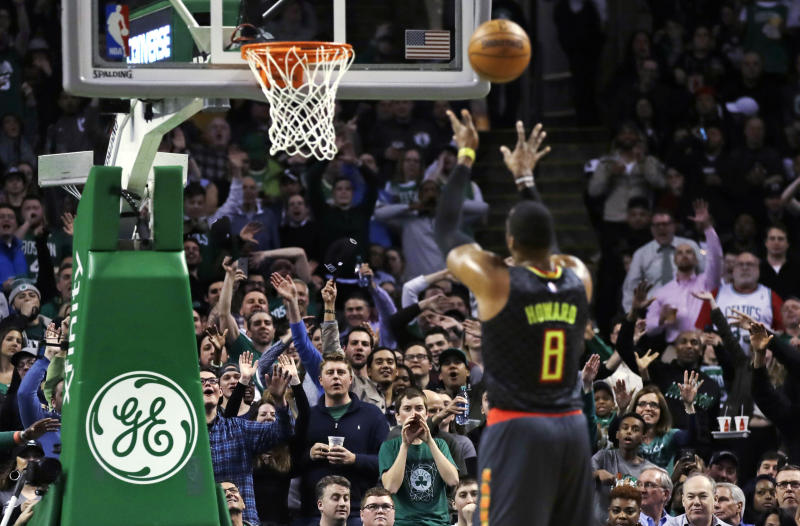 Boston Celtics fans taunt Atlanta Hawks center Dwight Howard (8) on a foul shot during the second half of an NBA basketball game in Boston, Monday, Feb. 27, 2017. The Hawks defeated the Celtics 114-98. (AP Photo/Charles Krupa)