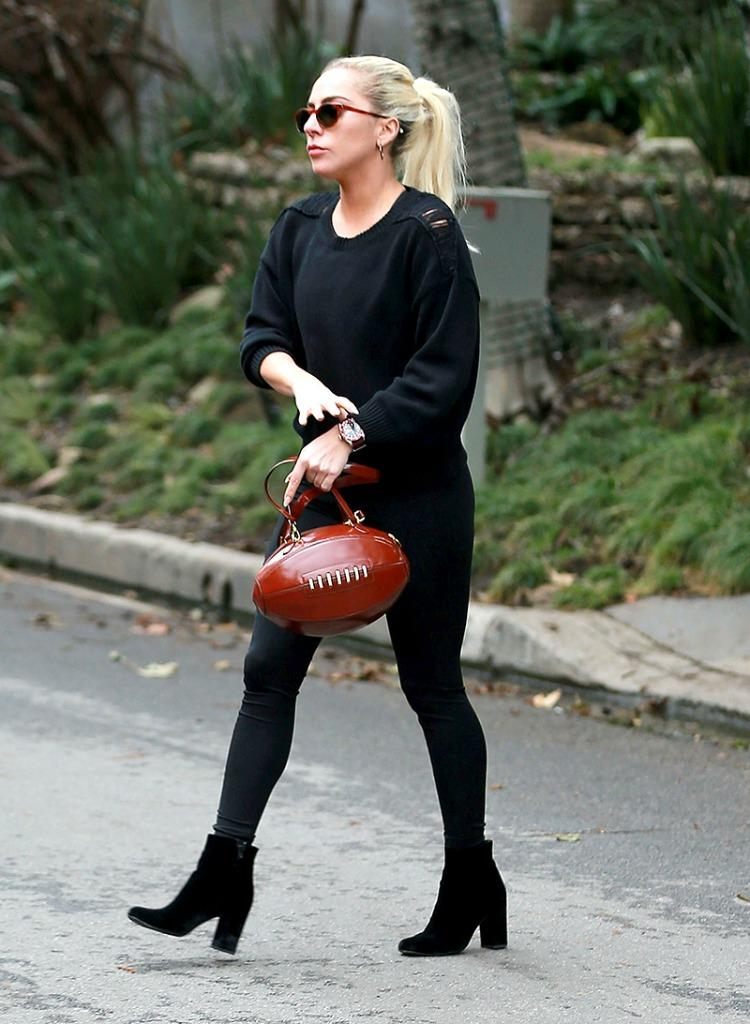 Gaga heads to the home of Bradley Cooper with a pigskin purse on her arm. (Photo: AKM-GSI)
