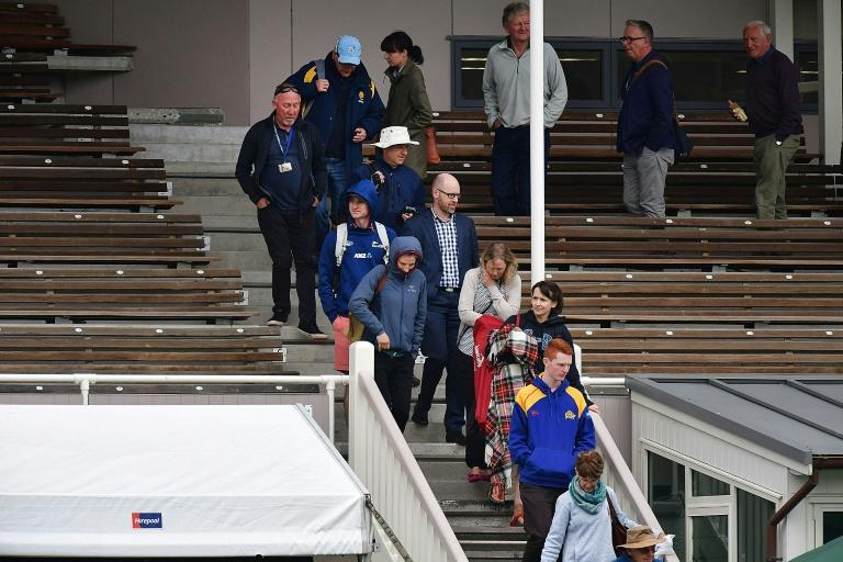 Members of the public are evacuated from the main stand after a fire alarm during day three of the first test between New Zealand and South Africa in Dunedin
