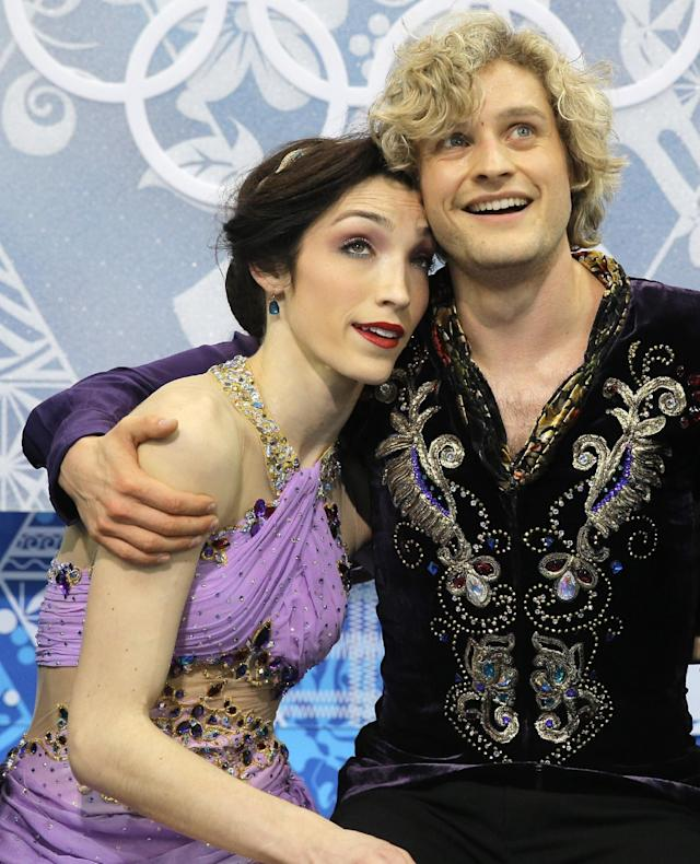 Meryl Davis and Charlie White of the United States embrace as they wait in the results area after competing in the ice dance free dance figure skating finals at the Iceberg Skating Palace during the 2014 Winter Olympics, Monday, Feb. 17, 2014, in Sochi, Russia. (AP Photo/Vadim Ghirda)