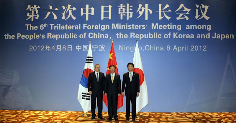 China's Foreign Minister Yang Jiechi, center, Japanese Foreign Minister Koichiro Gemba, right, and South Korean Foreign Minister Kim Sung-hwan, left, pose for a photo before the start of the 6th Trilateral Foreign Ministers' Meeting between China, Japan and South Korea in the eastern Chinese city of Ningbo on Sunday, April 8, 2012. (AP Photo/Peter Parks, Pool)