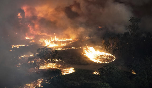 This Monday, Dec. 30, 2019 photo provided by State Government of Victoria shows wildfires in East Gippsland, Victoria state, Australia. Wildfires burning across Australia's two most-populous states trapped residents of a seaside town in apocalyptic conditions Tuesday, Dec. 31, and were feared to have destroyed many properties and caused fatalities. (State Government of Victoria via AP)