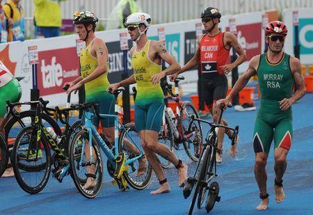 Triathlon - Gold Coast 2018 Commonwealth Games - Men's Final - Southport Broadwater Parklands - Gold Coast, Australia - April 5, 2018 - (From L) Luke Willian of Australia, Jacob Birtwhistle of Australia, Tyler Mislawchuk of Canada and Richard Murray of South Africa. REUTERS/Athit Perawongmetha