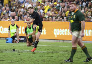 New Zealand's Jordie Barrett kicks the match winning penalty during the Rugby Championship test match between the Springboks and the All Blacks in Townsville, Australia, Saturday, Sept. 25, 2021. (AP Photo/Tertius Pickard)