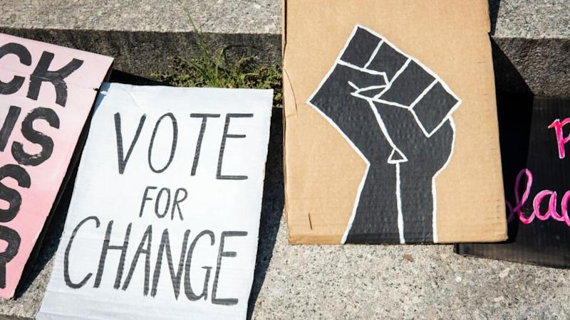 "Pancarta que dice ""Vote for change"""