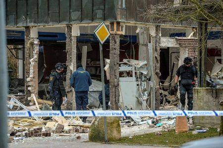 FILE PHOTO: Police officers stand at the scene of an explosion after what is believed to have been a robbery attempt on an ATM, in Genarp, southern Sweden March 21, 2016. REUTERS/Johan Nilsson/TT News Agency/File Photo   ATTENTION EDITORS - THIS IMAGE WAS PROVIDED BY A THIRD PARTY. FOR EDITORIAL USE ONLY. NOT FOR SALE FOR MARKETING OR ADVERTISING CAMPAIGNS. THIS PICTURE IS DISTRIBUTED EXACTLY AS RECEIVED BY REUTERS, AS A SERVICE TO CLIENTS. SWEDEN OUT. NO COMMERCIAL OR EDITORIAL SALES IN SWEDEN. NO COMMERCIAL SALES.