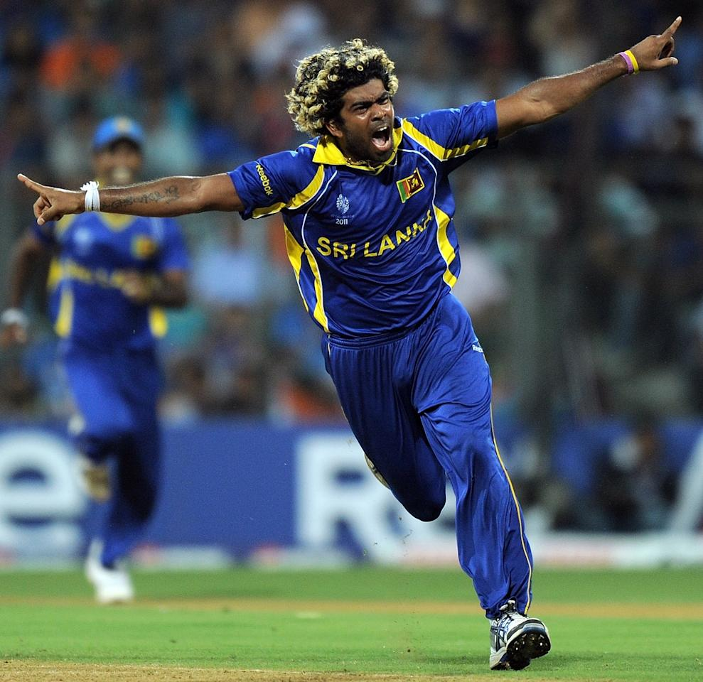 Sri Lankan fastbowler Lasith Malinga  reacts after taking the wicket of Indian cricketer Sachin Tendulkar during the ICC Cricket World Cup 2011 Final match at The Wankhede Stadium in Mumbai on April 2, 2011. AFP PHOTO/MANAN VATSYAYANA (Photo credit should read MANAN VATSYAYANA/AFP/Getty Images)