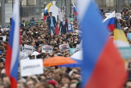 People attend a rally to demand authorities allow opposition candidates to run in a local election in Moscow