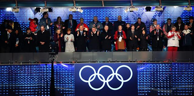 SOCHI, RUSSIA - FEBRUARY 07: (L-R) Anne Rogge, husband former International Olympic Committee (IOC) President Jacques Rogge, Yoo Soon-taek, Claudia Bach, UN Secretary General Ban Ki-moon, IOC President Thomas Bach and Russian President Vladimir Putin clap during the Opening Ceremony of the Sochi 2014 Winter Olympics at Fisht Olympic Stadium on February 7, 2014 in Sochi, Russia. (Photo by Martin Rose/Getty Images)