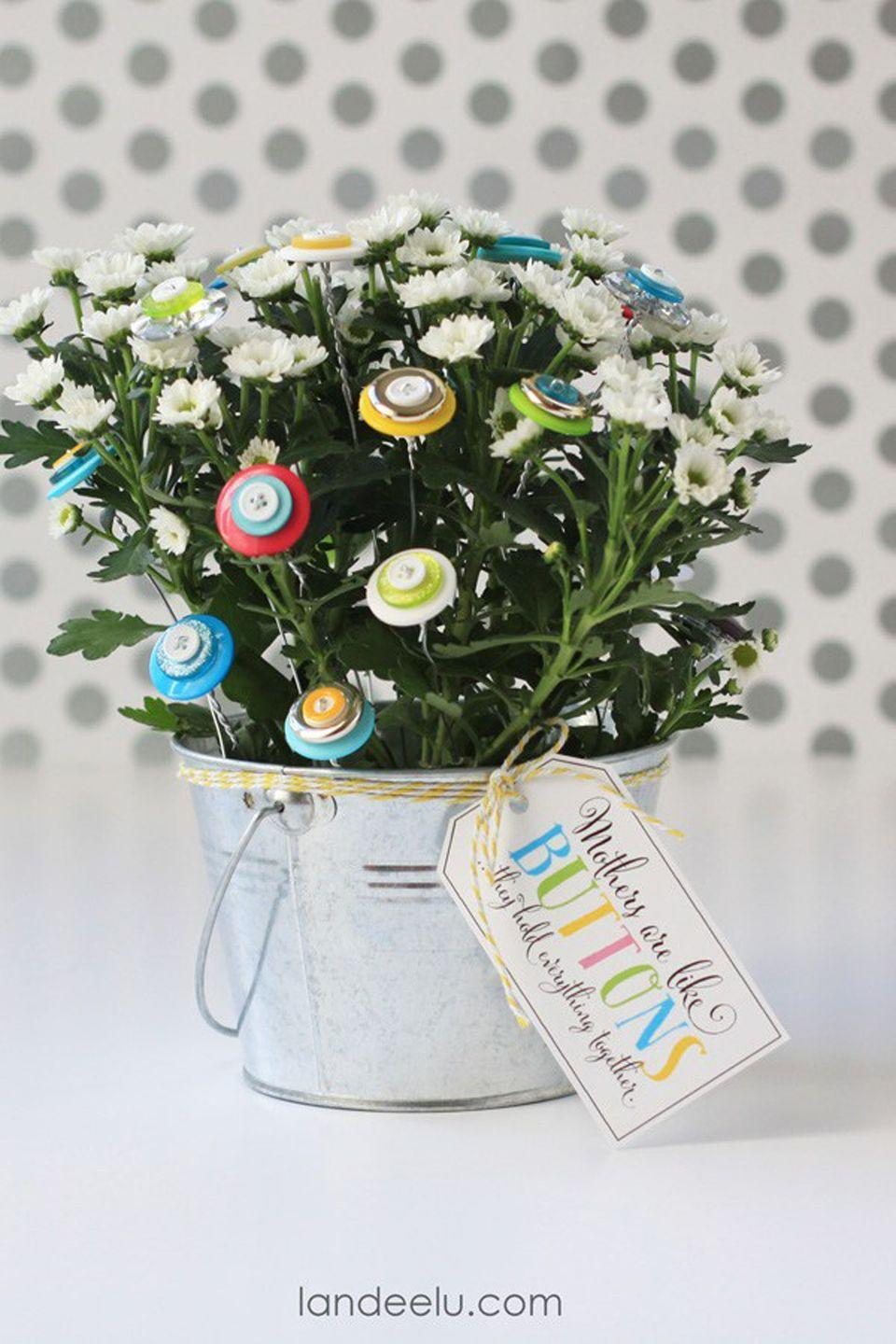 """<p>Buttons are a cute and easy addition to bouquets, especially ones with handpicked flowers.</p><p><strong>Get the tutorial at <a href=""""https://www.landeeseelandeedo.com/flower-craft-button-bouquet"""" rel=""""nofollow noopener"""" target=""""_blank"""" data-ylk=""""slk:Landeelu"""" class=""""link rapid-noclick-resp"""">Landeelu</a>.</strong></p><p><strong>What you'll need: </strong><em>assorted buttons ($6, </em><em><a href=""""https://www.amazon.com/School-Smart-Craft-Buttons-Assorted/dp/B003U6VSFM?tag=syn-yahoo-20&ascsubtag=%5Bartid%7C10050.g.2357%5Bsrc%7Cyahoo-us"""" rel=""""nofollow noopener"""" target=""""_blank"""" data-ylk=""""slk:amazon.com"""" class=""""link rapid-noclick-resp"""">amazon.com</a>); metal planter ($29, <a href=""""https://www.amazon.com/Behrens-1202-2-Quart-Dipped-Steel/dp/B0014CM2JK/ref=sr_1_13"""" rel=""""nofollow noopener"""" target=""""_blank"""" data-ylk=""""slk:amazon.com"""" class=""""link rapid-noclick-resp"""">amazon.com</a>)</em></p>"""