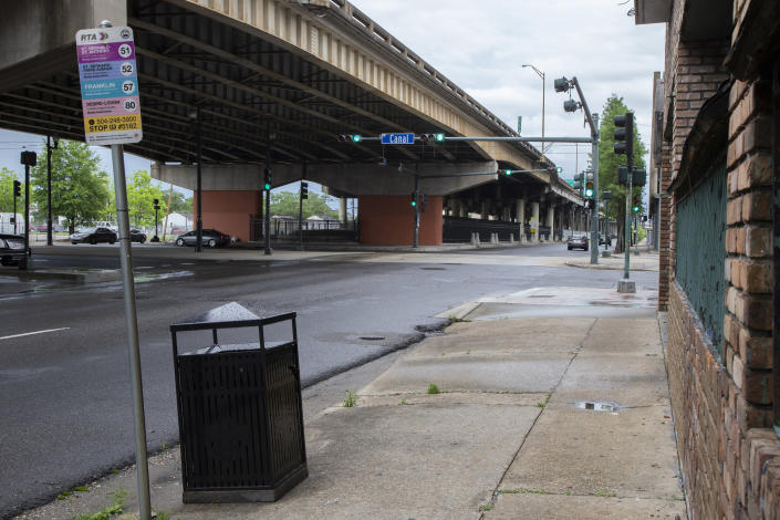 """The elevated freeway running along Claiborne Avenue in New Orleans crosses over Canal Street in this photo taken on May 11, 2021. Black businesses and culture thrived under the canopy of oak trees that lined Claiborne Avenue until the late 1960s, when the freeway was built directly on top of it — ripping up the trees and tearing apart a street sometimes called the """"Main Street of Black New Orleans."""" (AP Photo/Rebecca Santana)"""