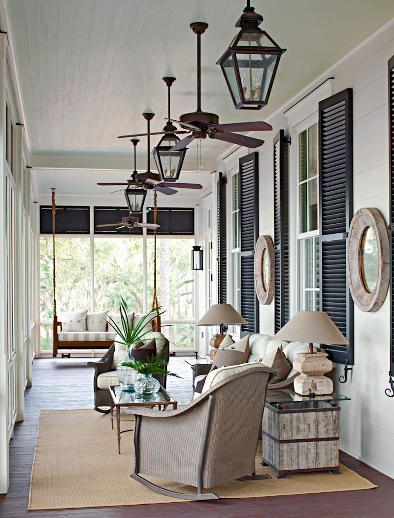 porch with shutters and hanging lanterns