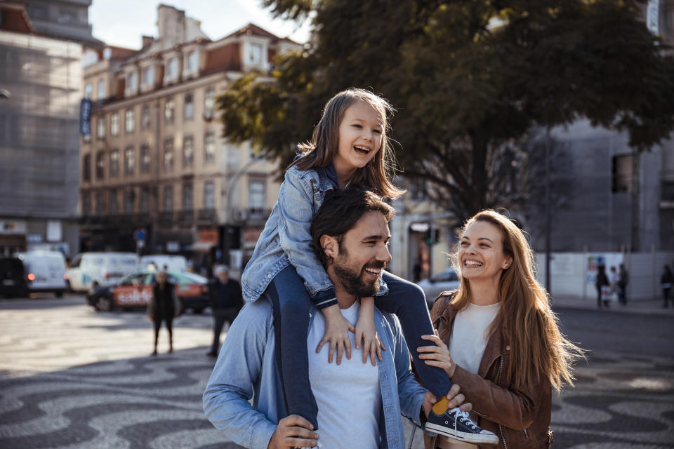 Close up of a young happy family having a walk in the city