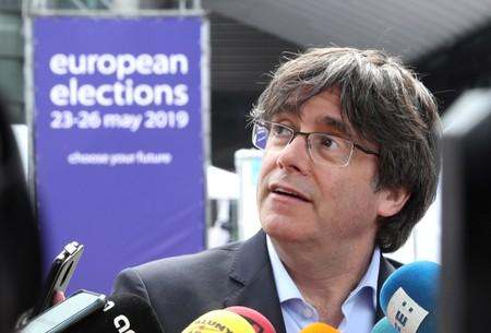 FILE PHOTO: Former Catalan President Carles Puigdemont talks to the media during European Parliament elections outside the EU Parliament in Brussels