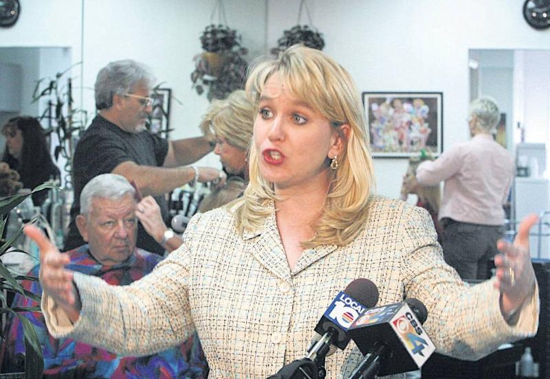 Tiffany Carr – shown during a 2004 visit to a Hollywood nail salon, where she spoke on domestic violence – was the longtime CEO of the Florida Coalition Against Domestic Violence.