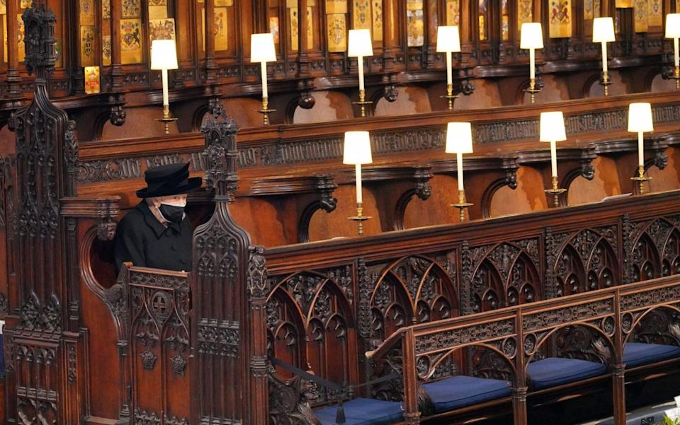 The Queen sat alone in St George's Chapel for the funeral of Prince Philip - Jonathan Brady/PA