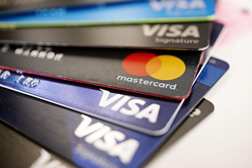Visa Inc. and Mastercard Inc. credit cards are arranged for a photograph in Tiskilwa, Illinois, U.S., on Tuesday, Sept. 18, 2018. Visa and Mastercard agreed to pay as much as $6.2 billion to end a long-running price-fixing case brought by merchants over card fees, the largest-ever class action settlement of an antitrust case. Photographer: Daniel Acker/Bloomberg via Getty Images