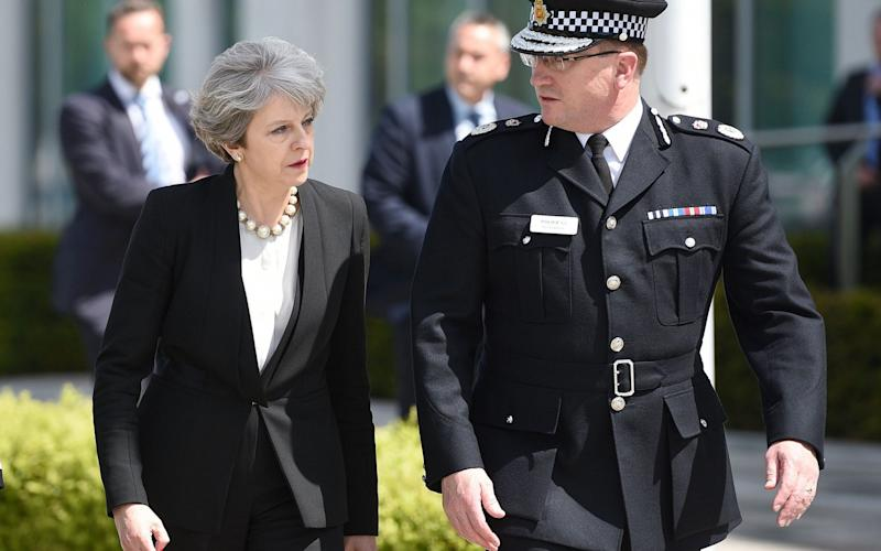 Ian Hopkins, chief constable of Greater Manchester, with Theresa May - AFP