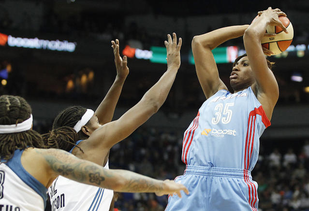 Atlanta Dream guard Angel McCoughtry (35) takes a shot at the basket against Minnesota Lynx forward Rebekkah Brunson during Game 1 of the WNBA basketball finals, Sunday, Oct. 6, 2013, in Minneapolis. (AP Photo/Stacy Bengs)