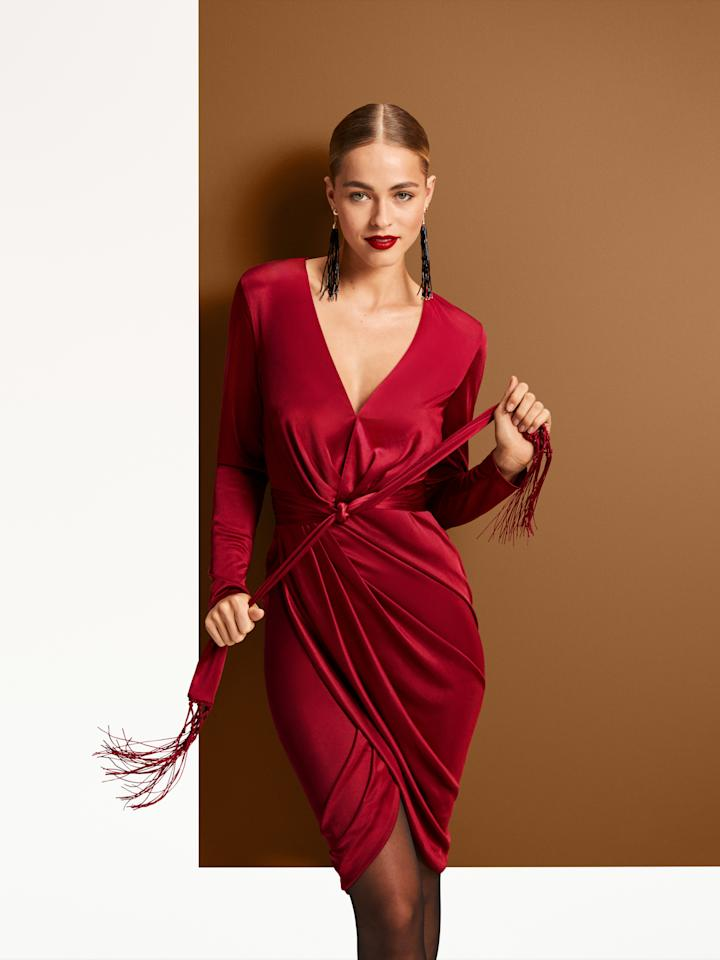 "Altuzarra for Target Long Sleeve Deep V-Neck Wrap Dress, $50, <a href=""https://www.target.com/p/women-s-long-sleeve-deep-v-neck-wrap-dress-altuzarra-for-target-red/-/A-54617576?preselect=54565606#lnk=sametab"" rel=""nofollow"">target.com</a>. Sizes 1X-3X <a href=""https://www.target.com/p/women-s-plus-size-long-sleeve-deep-v-neck-wrap-dress-altuzarra-for-target-red/-/A-54617577?preselect=54565680#lnk=sametab"" rel=""nofollow"">available here</a>."