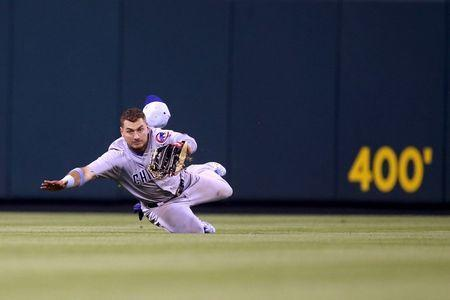 Jun 17, 2018; St. Louis, MO, USA; Chicago Cubs center fielder Albert Almora Jr. (5) makes a diving catch for an out during the ninth inning against the St. Louis Cardinals at Busch Stadium. Mandatory Credit: Scott Kane-USA TODAY Sports