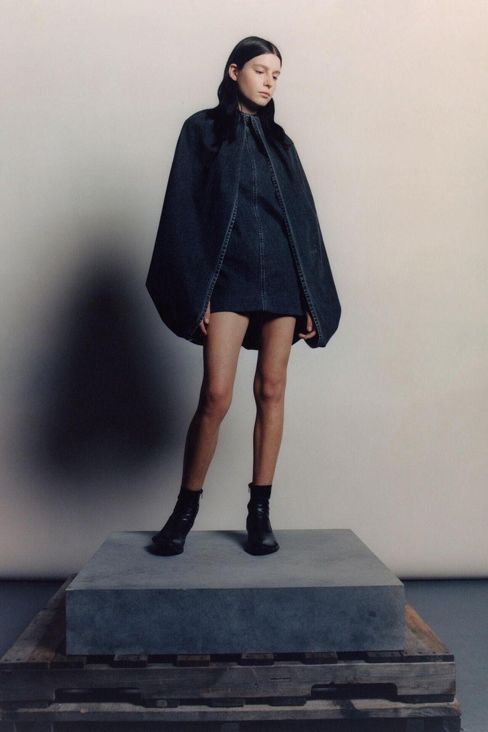 """<p>Spring 2021 marks the 5th anniversary of LRS, designer Raul Solís's genderless—or """"Gender X"""" as he likes to call it—collection. And to celebrate the occasion, the Proenza Schouler alum served up the cool denim he's known for in new elevated shapes, including knee-length tailored shorts and a couture-like bubble mini dress with a built in cape. His signature wit and new attention to silhouette were also evident in an ethereal blue acetate overcoat with heavy chain details and an XL ribbed turtleneck dress that can be worn above the nose as a face covering, while leaving the midriff exposed. <em>—Alison S. Cohn</em></p>"""