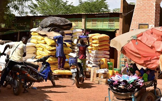 With the lack of work in Burkina's north, many people say they are struggling to feed their families (AFP Photo/ISSOUF SANOGO)