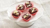 """<p>This red velvet fudge is one of <a href=""""https://www.thedailymeal.com/holidays/edible-holiday-gifts-fudge-granola-jam-truffles?referrer=yahoo&category=beauty_food&include_utm=1&utm_medium=referral&utm_source=yahoo&utm_campaign=feed"""" rel=""""nofollow noopener"""" target=""""_blank"""" data-ylk=""""slk:the best edible gifts"""" class=""""link rapid-noclick-resp"""">the best edible gifts</a> to give during the holiday season. But really, you should share the love (and the chocolate) all year long.</p> <p><a href=""""https://www.thedailymeal.com/recipes/red-velvet-truffle-fudge-recipe?referrer=yahoo&category=beauty_food&include_utm=1&utm_medium=referral&utm_source=yahoo&utm_campaign=feed"""" rel=""""nofollow noopener"""" target=""""_blank"""" data-ylk=""""slk:For the Red Velvet Truffle Fudge recipe, click here."""" class=""""link rapid-noclick-resp"""">For the Red Velvet Truffle Fudge recipe, click here.</a></p>"""