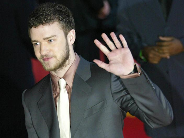 Justin Timberlake waves to the photographers as he arrives for the Brit Awards 2004 Getty Images
