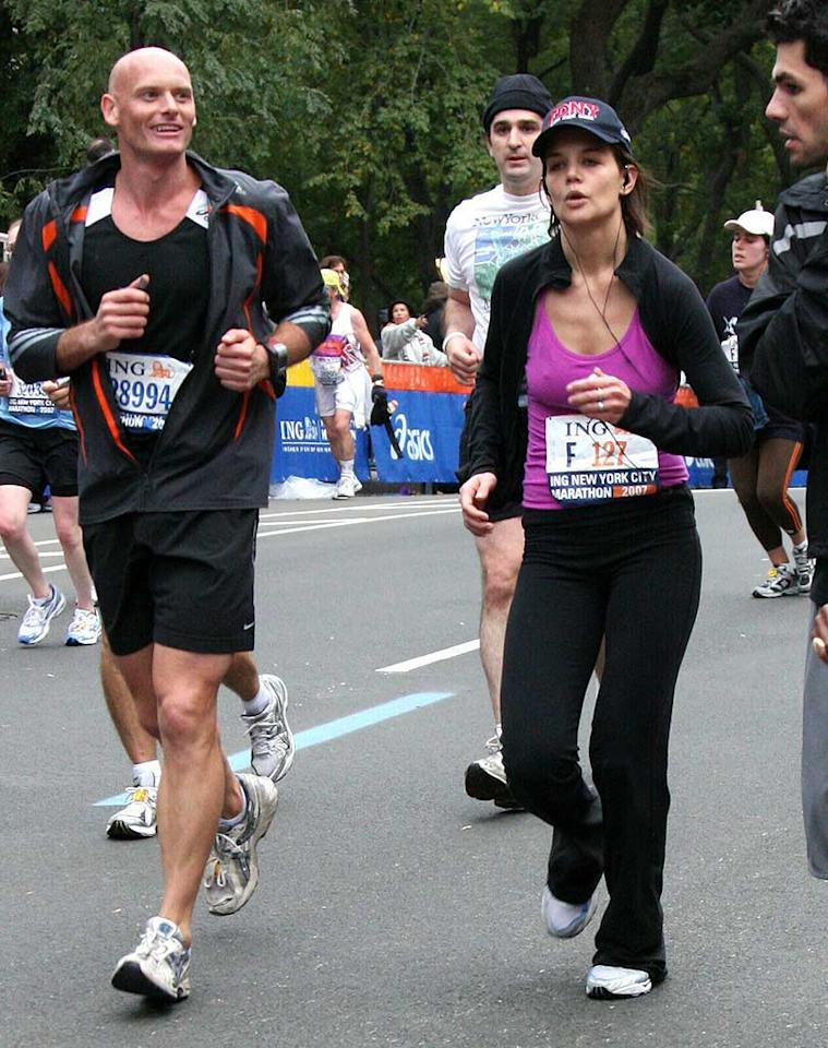"""Katie Holmes competes in the grueling NYC Marathon sans Tom, who was busy whipping up a batch of barley milk and Scientology snacks for baby Suri. Janet Mayer/<a href=""""http://www.splashnewsonline.com"""" target=""""new"""">Splash News</a> - November 4, 2007"""