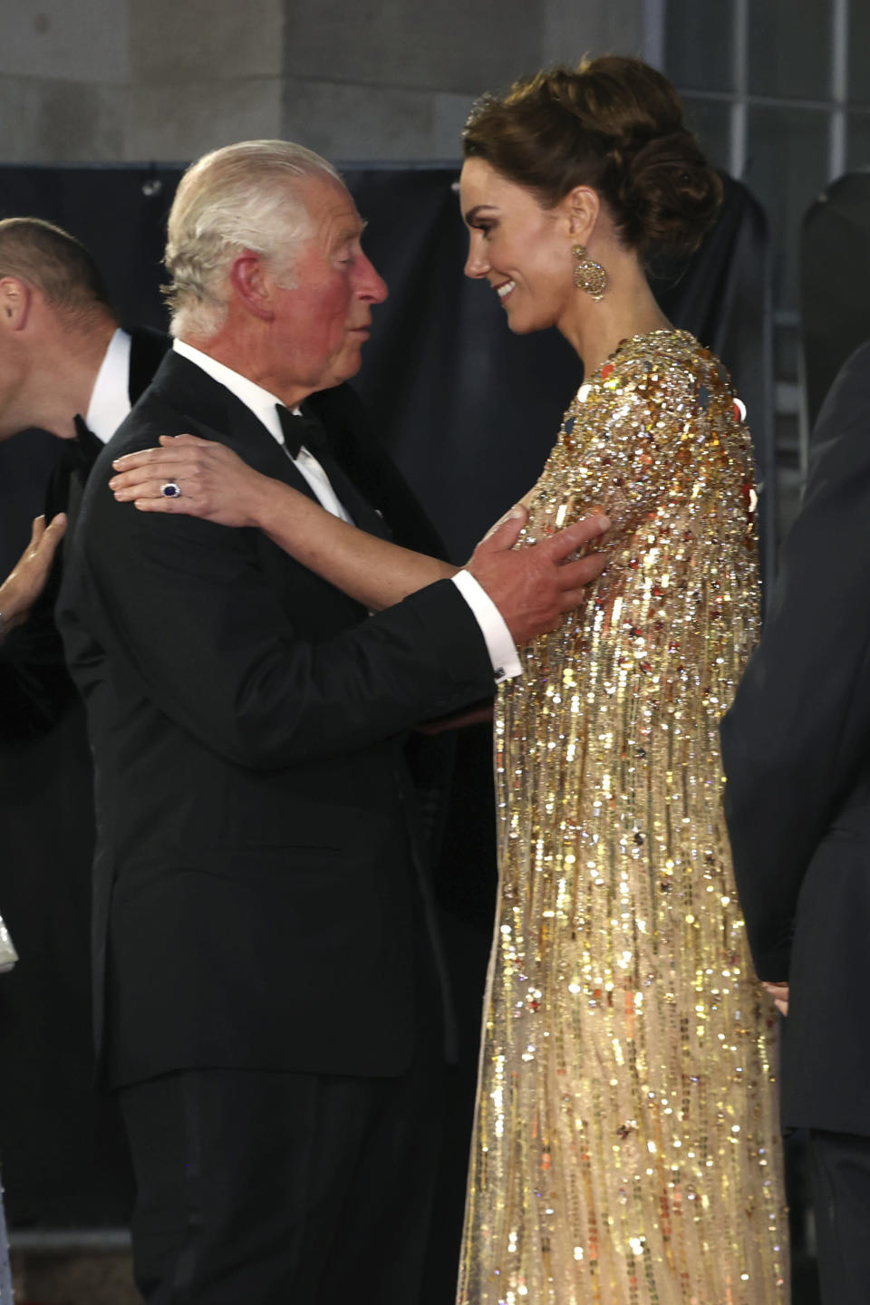 Britain's Prince Charles, left, reacts with Kate, the Duchess of Cambridge as they arrive for the World premiere of the new film from the James Bond franchise 'No Time To Die', in London, Tuesday, Sept. 28, 2021. (Chris Jackson/Pool Photo via AP)