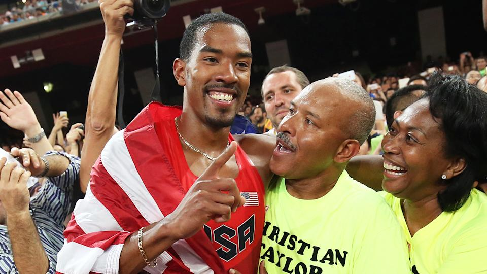 Christian Taylor (pictured left) celebrates gold with his family at the world athletics championships.