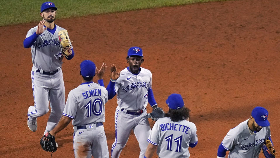 Toronto Blue Jays outfielder Jonathan Davis, celebrates with teammates after the Blue Jays defeated the Boston Red Sox 6-3 in a baseball game at Fenway Park, Wednesday, April 21, 2021, in Boston. (AP Photo/Charles Krupa)