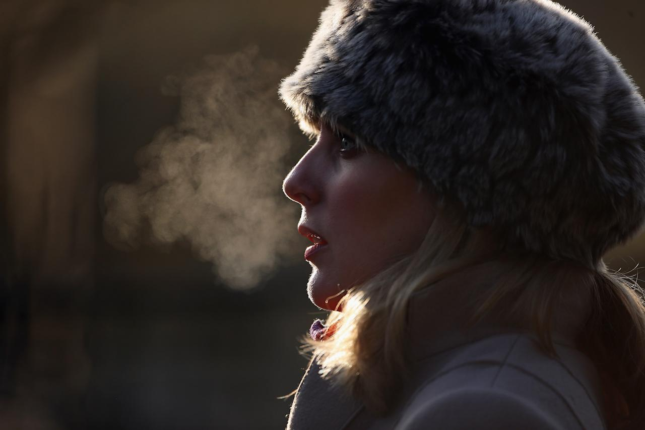 LONDON, ENGLAND - DECEMBER 12:  A woman's breath is backlit on a freezing morning in Regents Park on December 12, 2012 in London, England. Forecasters have warned that the UK could experience the coldest day of the year so far today, with temperatures dropping as low as -14C, bringing widespread ice, harsh frosts and freezing fog. Travel disruption is expected with warnings for heavy snow in some parts of the country.  (Photo by Dan Kitwood/Getty Images)
