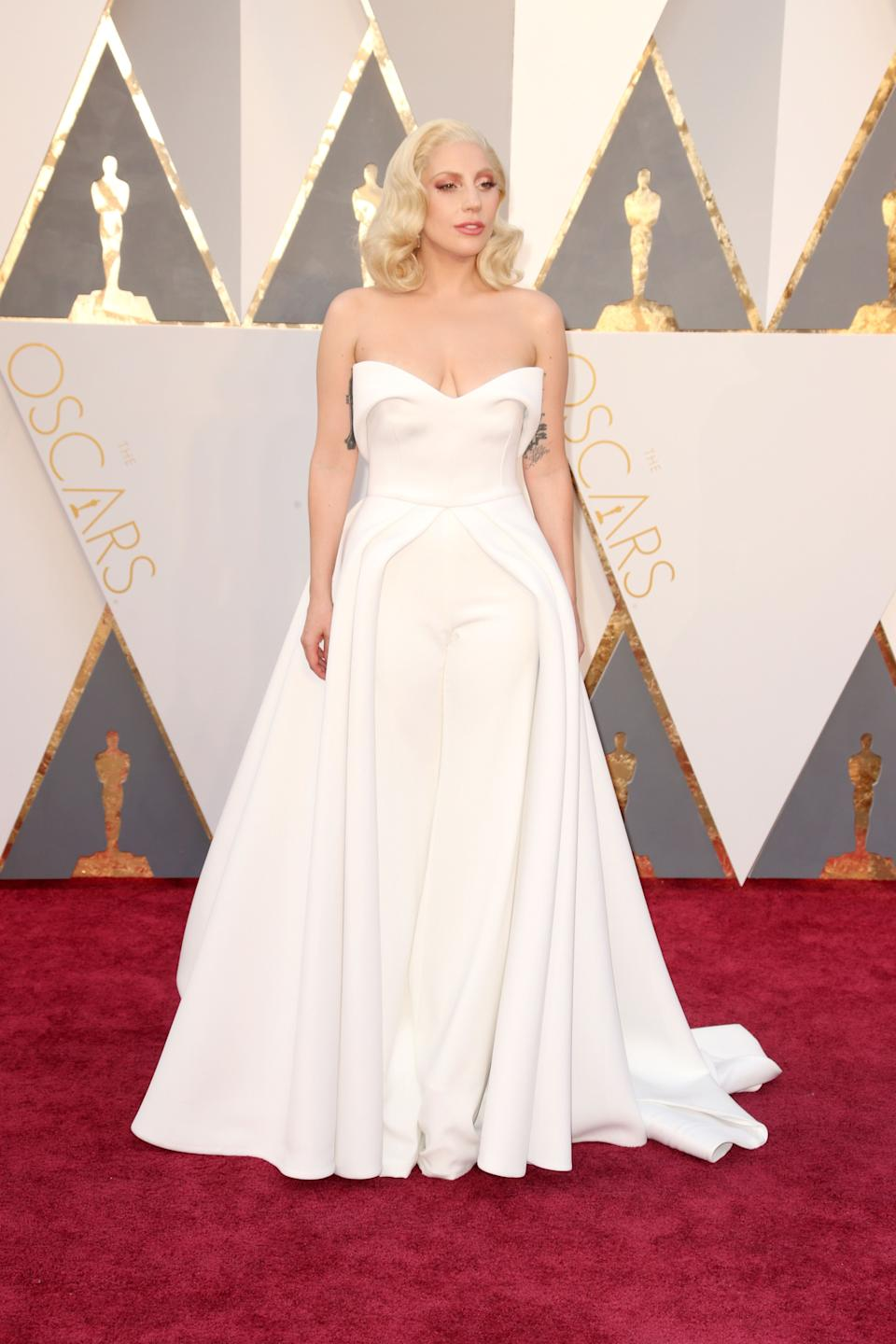 Gaga stuns in a structured white look by Brandon Maxwell at the 2016 Academy Awards in Hollywood.
