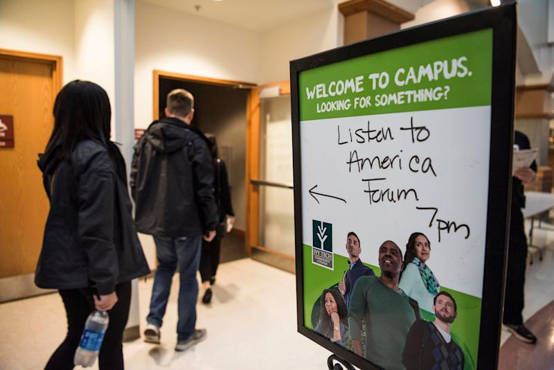 """A sign directs guests to the """"Vouchers: The Economics and Academics of Choice"""" event at Ivy Tech Community College in Fort Wayne."""