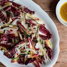"""A sprinkling of fresh chopped chives adds an extra pop of color to this elegant Thanksgiving salad recipe. <a href=""""https://www.epicurious.com/recipes/food/views/-radicchio-shaved-fennel-and-pomegranate-salad-51254420?mbid=synd_yahoo_rss"""" rel=""""nofollow noopener"""" target=""""_blank"""" data-ylk=""""slk:See recipe."""" class=""""link rapid-noclick-resp"""">See recipe.</a>"""