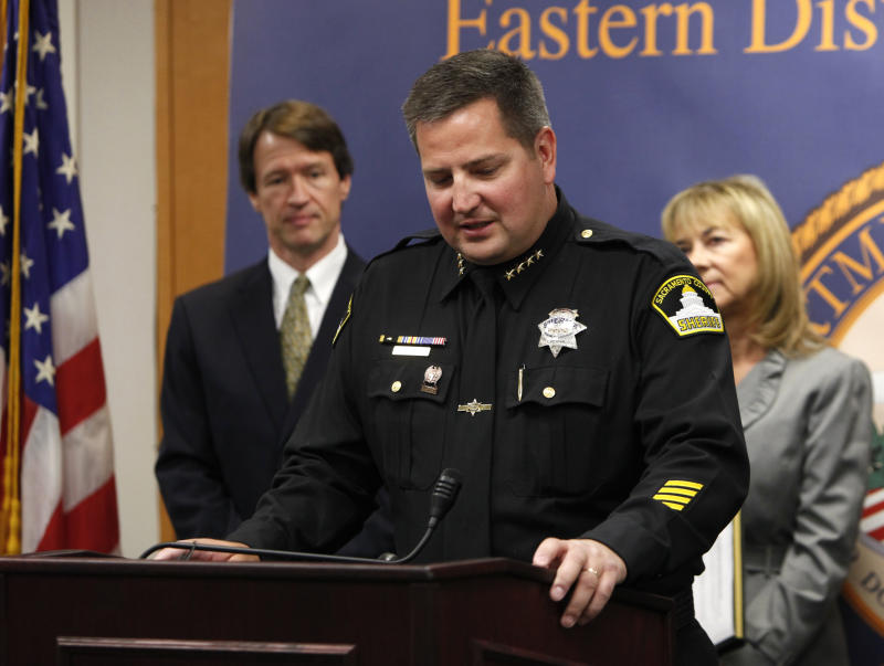 CORRECTS SPELLING OF U.S. ATTORNEY'S LAST NAME FROM WAGONER TO WAGNER - Sacramento County Sheriff Scott Jones pauses as he discusses the federal charges brought against two of his deputies for allegedly illegally selling dozens of weapons, at a news conference  in Sacramento, Calif., Friday,  June 1, 2012. Deputies Ryan McGowan, 31, and Thomas Lu, 42, face charges of trafficking in handguns that cannot be legally bought by citizens in California.  Standing behind Jones are U.S. Attorney Benjamin Wagner, left, and Sacramento County District Attorney Jan Scully. (AP Photo/Rich Pedroncelli)