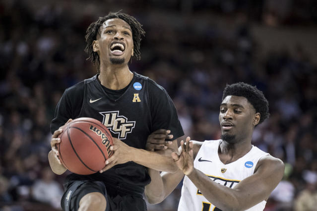 Central Florida guard Terrell Allen (2) drives to the basket against VCU guard Vince Williams (10) during the first half of a first-round game in the NCAA men's college basketball tournament Friday, March 22, 2019, in Columbia, S.C. (AP Photo/Sean Rayford)