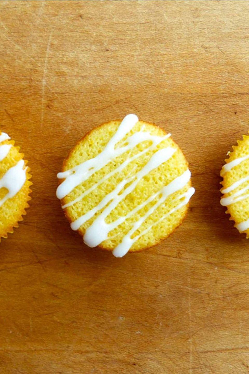 """<p>Theses cupcakes deliver a fresh citrus flavor without falling into the trap of being overly sweet or sour. </p><p><strong><em><a href=""""https://www.womansday.com/food-recipes/food-drinks/recipes/a39975/orange-olive-oil-cupcakes-recipe-ghk0514/"""" rel=""""nofollow noopener"""" target=""""_blank"""" data-ylk=""""slk:Get the Orange Olive Oil Cupcakes recipe."""" class=""""link rapid-noclick-resp"""">Get the Orange Olive Oil Cupcakes recipe. </a></em></strong></p>"""