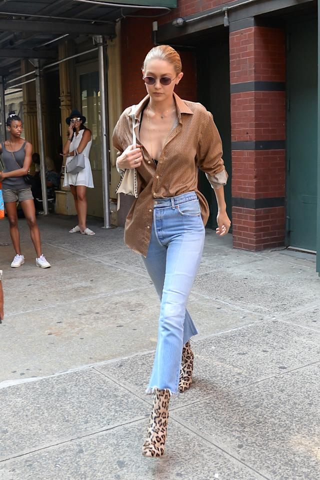 <p>In an Etro shirt, high-waisted blue jeans and leopard print booties while out in NYC. </p>