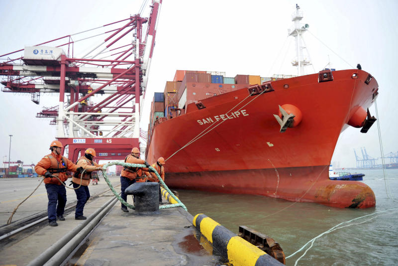 China's February exports surge, trade surplus widens