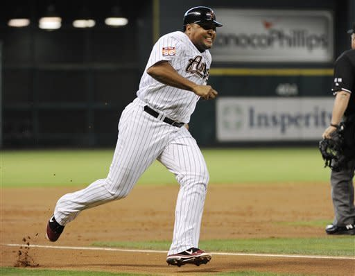 Houston Astros' Carlos Lee runs down the third base lane to score from first on a Jed Lowrie RBI double during the second inning of a baseball game against the Milwaukee Brewers Wednesday, May 16, 2012, in Houston. (AP Photo/Pat Sullivan)