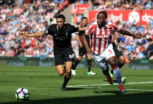 <p>Liverpool's Trent Alexander-Arnold (left) and Stoke City's Saido Berahino battle for the ball</p>